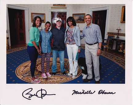 Randy Tharp with the Obama presidental family.