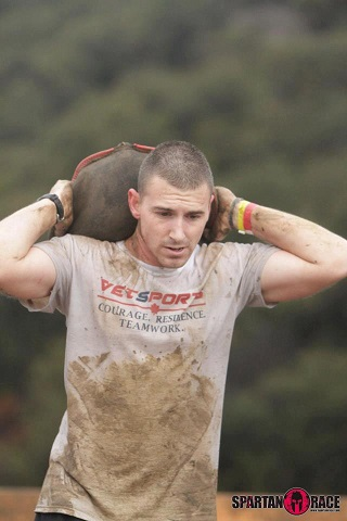Vetsports veteran, towing the line (carrying heavy boulder to finish line) in Spartan Race.